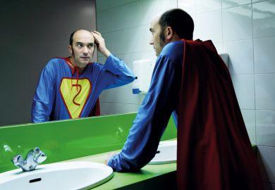 Balding superhero checking hair in mirror