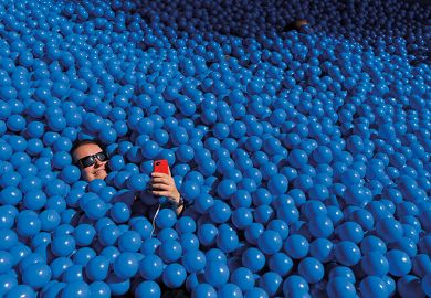 Person taking a selfie in a ball pit