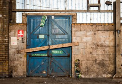 A barred door in a warehouse