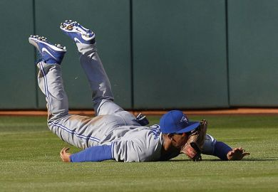 Baseball player Anthony Gose, Toronto Blue Jays, falls on ground