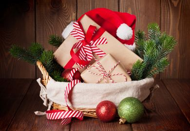 Basket of gift-wrapped Christmas presents
