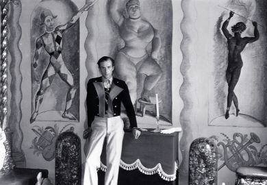 Cecil Beaton at home in 1934, with murals by Pavel Tchelitchew, Rex Whistler, Oliver Messel et al.