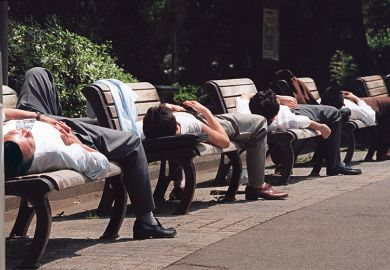 Men sleeping on benches