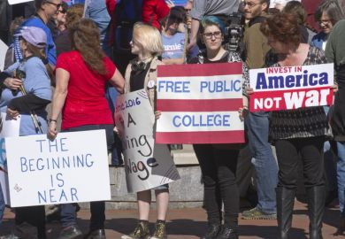 Bernie Sanders supporters with a free college sign