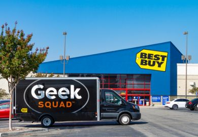 A large Geek Squad van is parked at the Best Buy retail store located in Montclair, California.