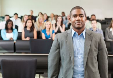 A black academic in a lecture hall