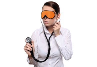 Blindfolded woman holding stethoscope