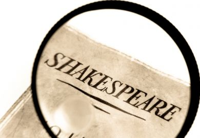 Book by Shakespeare under a magnifying glass
