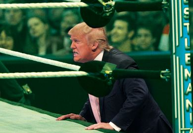 Trump next to a wrestling ring