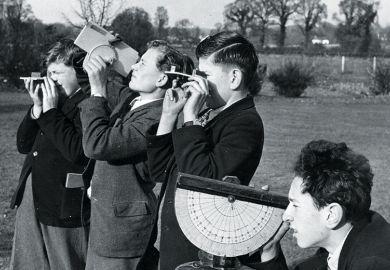 boys practise surveying