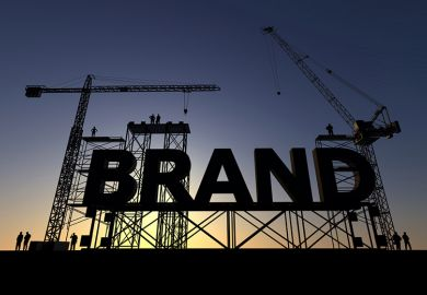 "A giant sign reading ""Brand"" on scaffolding"