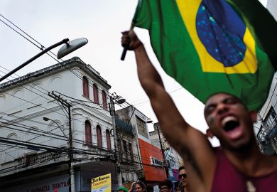 Man waves Brazilian flag