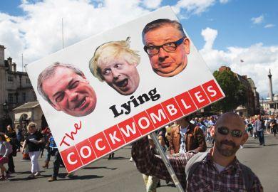 Brexit demonstrator holding sign of Nigel Farage, Boris Johnson and Michael Gove