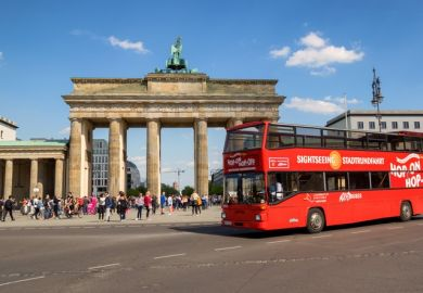 A double-decker bus at the Brandenburg Gate