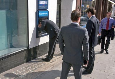 Business men at ATM