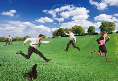 Business people running through field