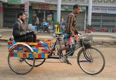 Businessman being transported on rickshaw