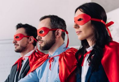 Businessmen and woman in superhero outfits
