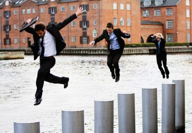 Businesspeople jumping across pillars in city river