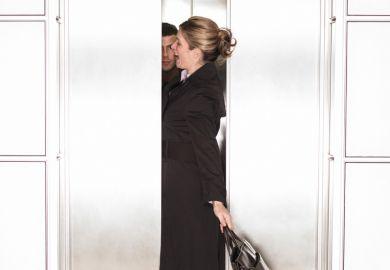 Businesswoman squeezing through elevator/lift doors