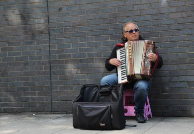 Busker playing the accordion
