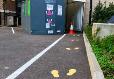 Cambridge UK, England ,24-11-2020, Painted footprints on asphalt outside University covid test station. The University offers swab tests to College and University staff and students displaying symptoms