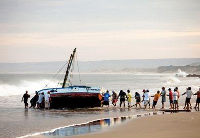 Capsized boat on beach
