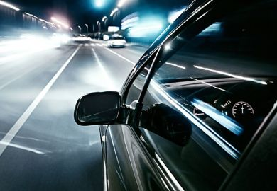 Car driving quickly into European motorway fast lane