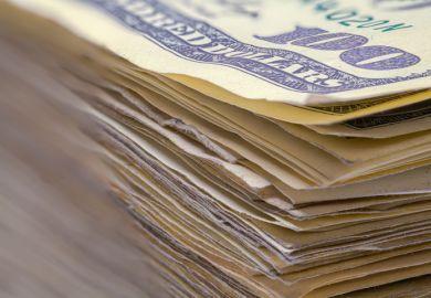 A pile of $100 dollar bills