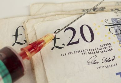 a syringe with a £20 note