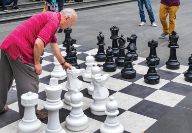 Man playing outdoor chess