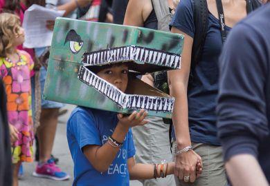 Child in dinosaur costume