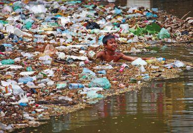 Child swimming in plastic rubbish