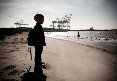 A child standing on a beach