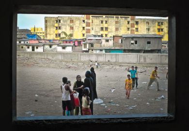 Children playing, viewed through open window, Dharavi, Mumbai