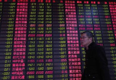 Chinese man by currency exchange board