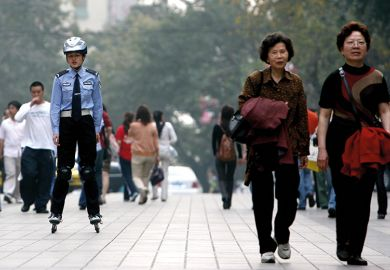Chinese police officer on rollerblades