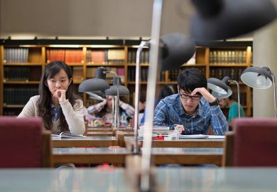 Chinese students in a library