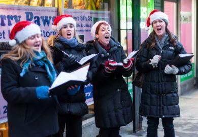 Christmas carollers in Santa hats