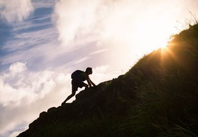Person climbing a slope
