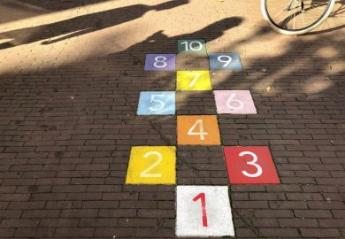 Colourful tiles in an Amsterdam sidewalk for playing hopscotch