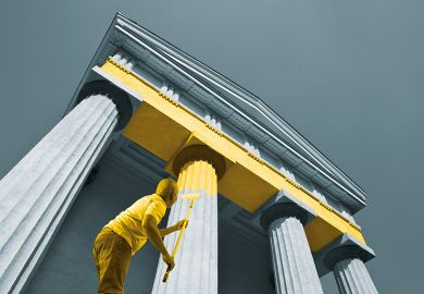 Man paints columns yellow