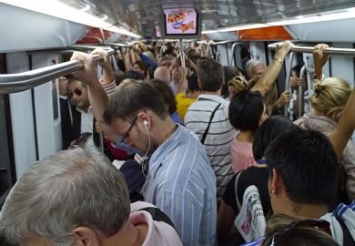 Commuters packed into overcrowded subway train