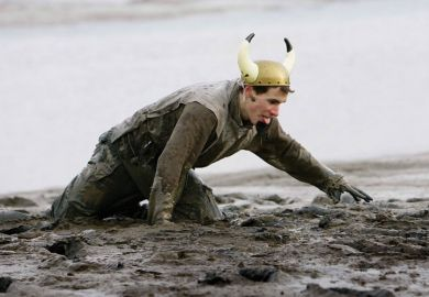 Competitor struggles during Maldon Mud Race, Essex