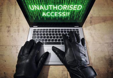 Computer cracker illegally accessing Apple MacBook laptop