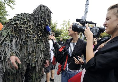 A raver is interviewed by a local TV crew during the 19th annual Techno Street Parade in Zurich