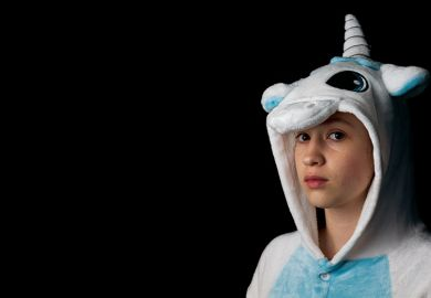 student in unicorn onesie