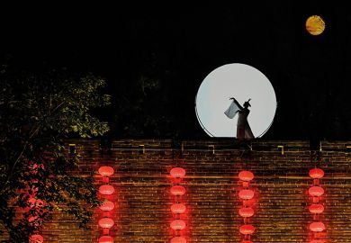 Asian woman on a wall in moonlight