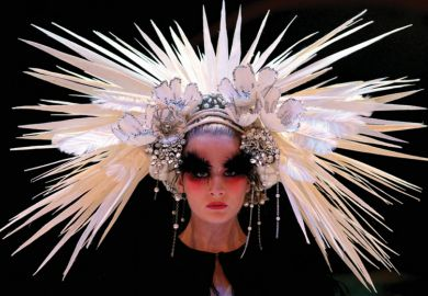Female model wearing elaborate headdress