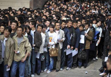 Crowd of graduates waiting for job fair, China